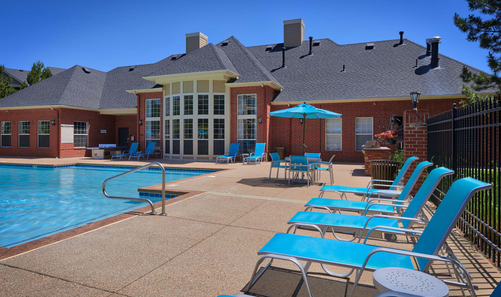 poolside view with lounge chairs at Skyecrest Apartments