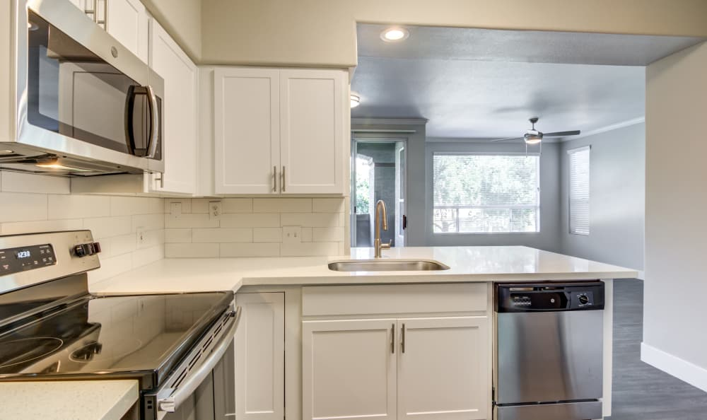 Granite countertops in modern kitchen of model home at Lumiere Chandler in Chandler, Arizona