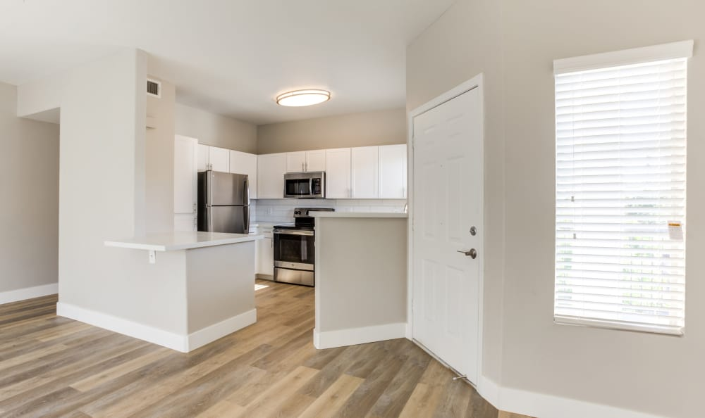 Open-concept floor plan with hardwood floors in an apartment home at Finisterra in Tempe, Arizona