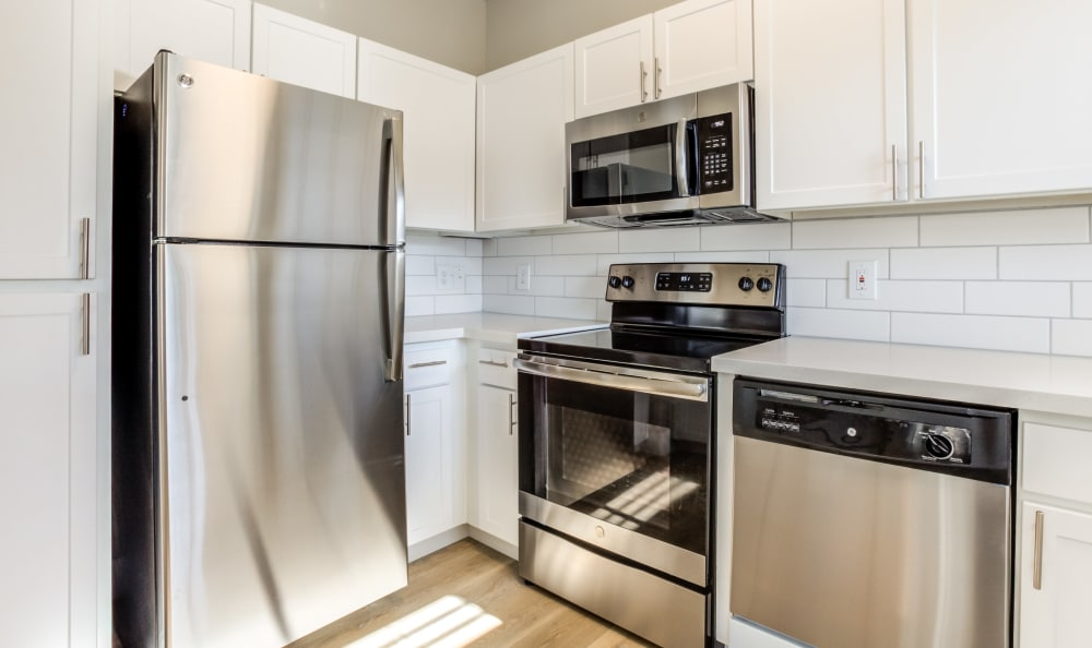 Stainless-steel appliances and a subway tile backsplash in a model home's kitchen at Finisterra in Tempe, Arizona