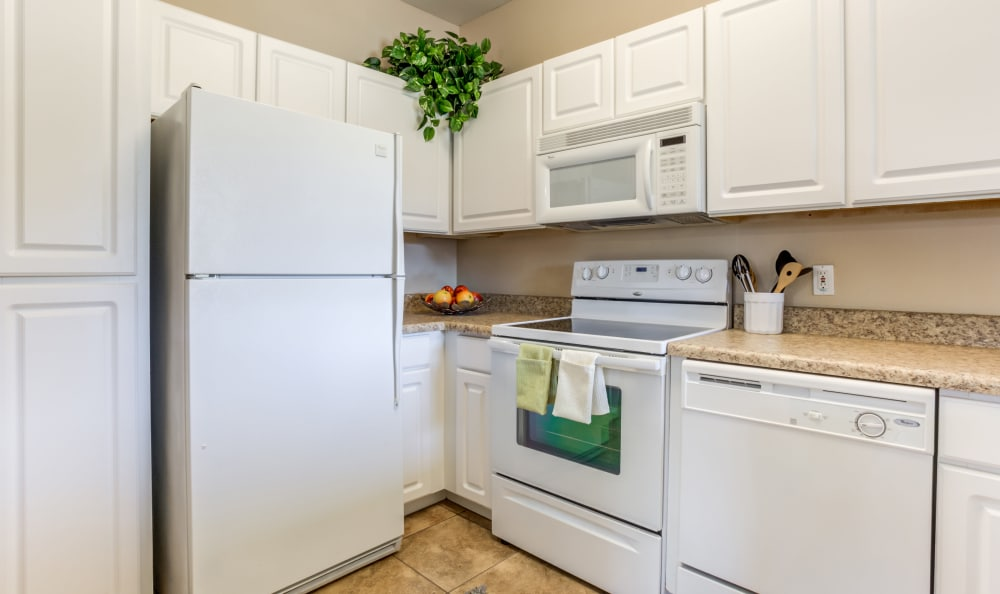 White appliances and matching cabinetry in the gourmet kitchen of a model home at Finisterra in Tempe, Arizona