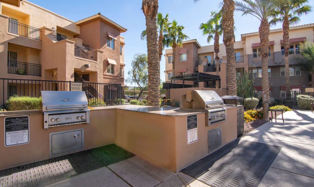 Barbecue area with gas grills at The Residences at Stadium Village in Surprise, Arizona