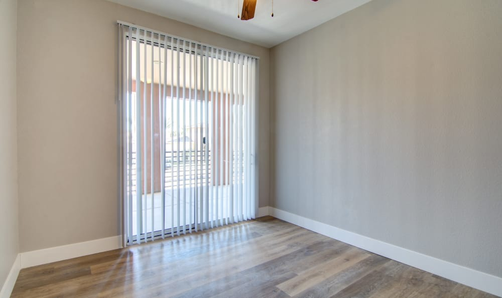Sliding door to private balcony in apartment home at The Residences at Stadium Village in Surprise, Arizona