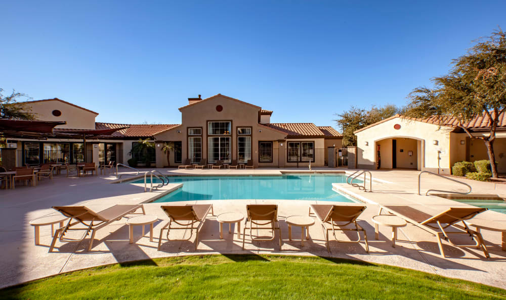 Pool deck and sun chairs at Waterford at Peoria in Peoria, AZ