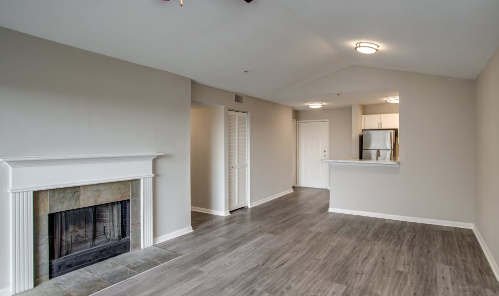 Fireplace and hardwood floors in renovated apartment home at Kenwood Club at the Park in Katy, Texas