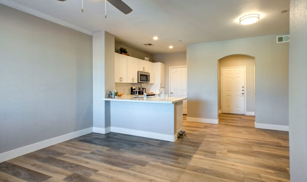 Naturally-well-lit living room and kitchen at Waterford at Peoria in Peoria, AZ