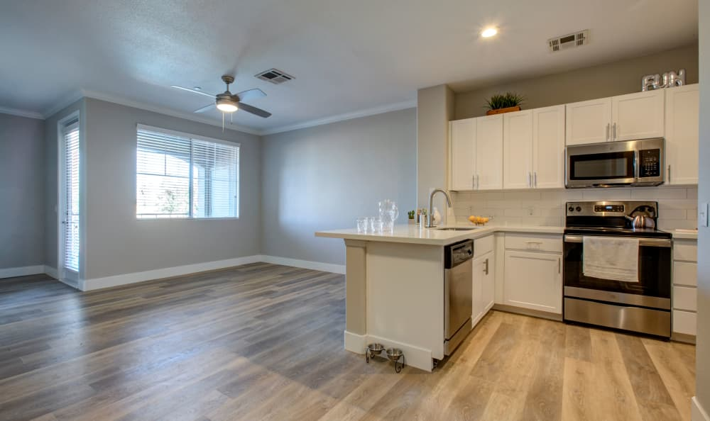 Modern living room and kitchen at Waterford at Peoria in Peoria, AZ