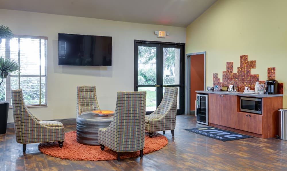 Coffee bar and comfortable cafe-style seating in the clubhouse at IMT Pinebrook Pointe in Margate, Florida