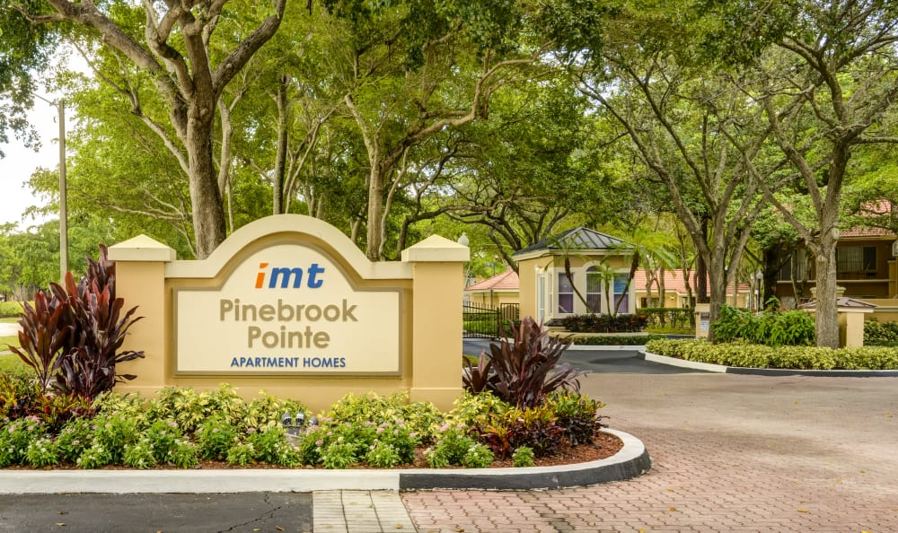 Our monument sign welcoming residents and their guests to our community at IMT Pinebrook Pointe in Margate, Florida