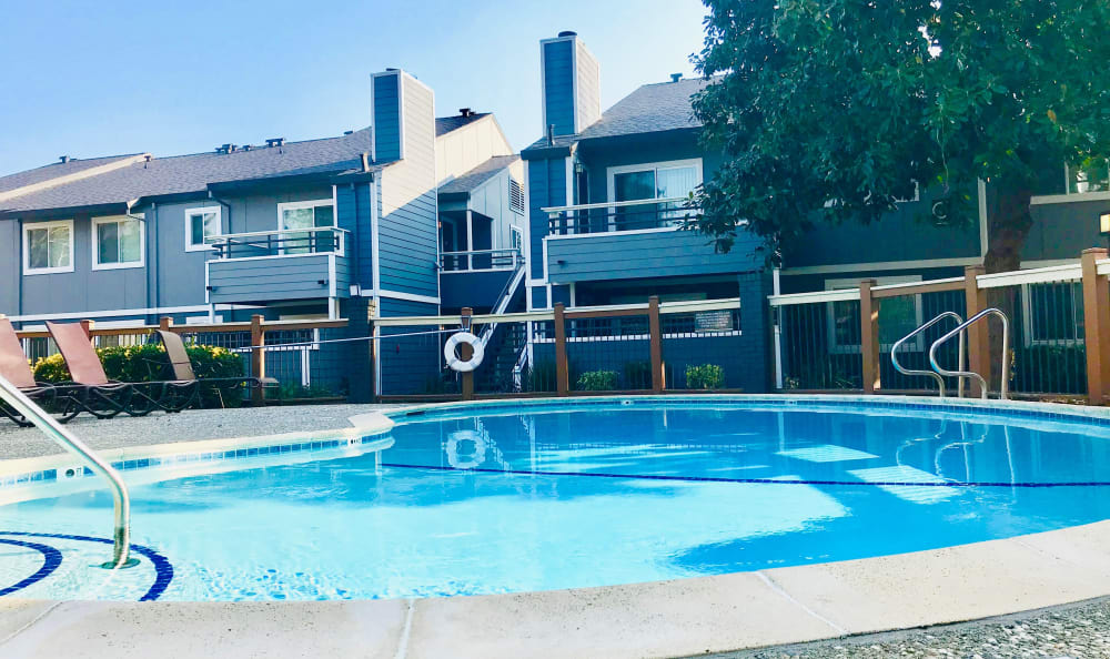 Chill by the pool at Bennington Apartments