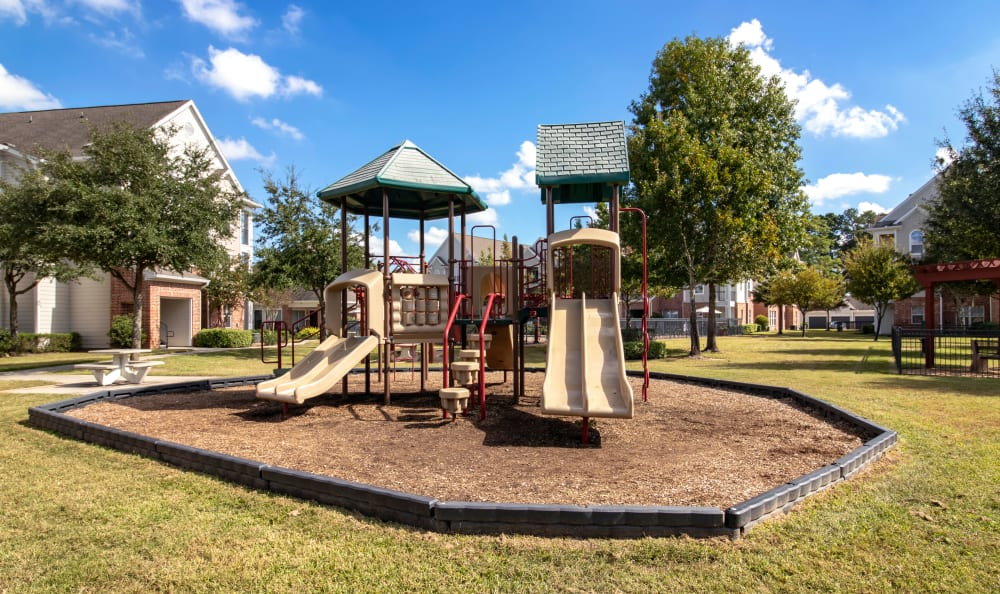 Onsite playground adjacent to picnic tables at IMT Kingwood in Kingwood, Texas