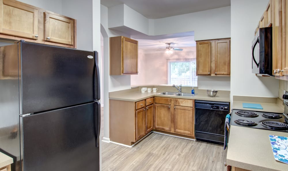Large kitchen with wooden cabinets at IMT Kingwood in Kingwood, Texas