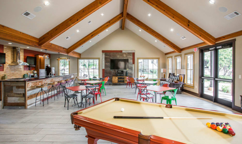 Resident clubhouse with a billiards table and more at Riata Austin in Austin, Texas