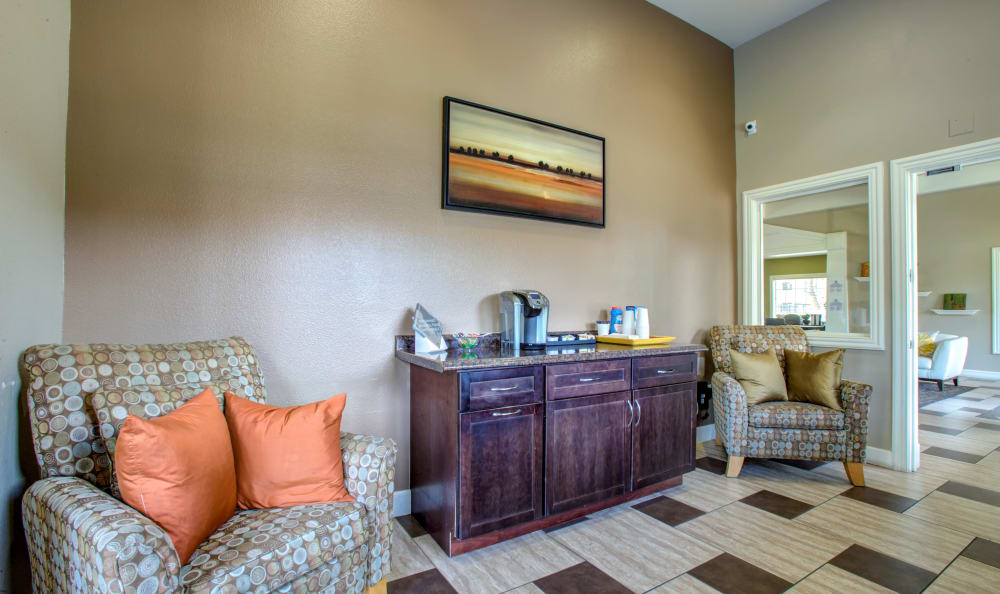 Comfortable seating and a coffee bar in the leasing office at Sierra Canyon in Glendale, Arizona