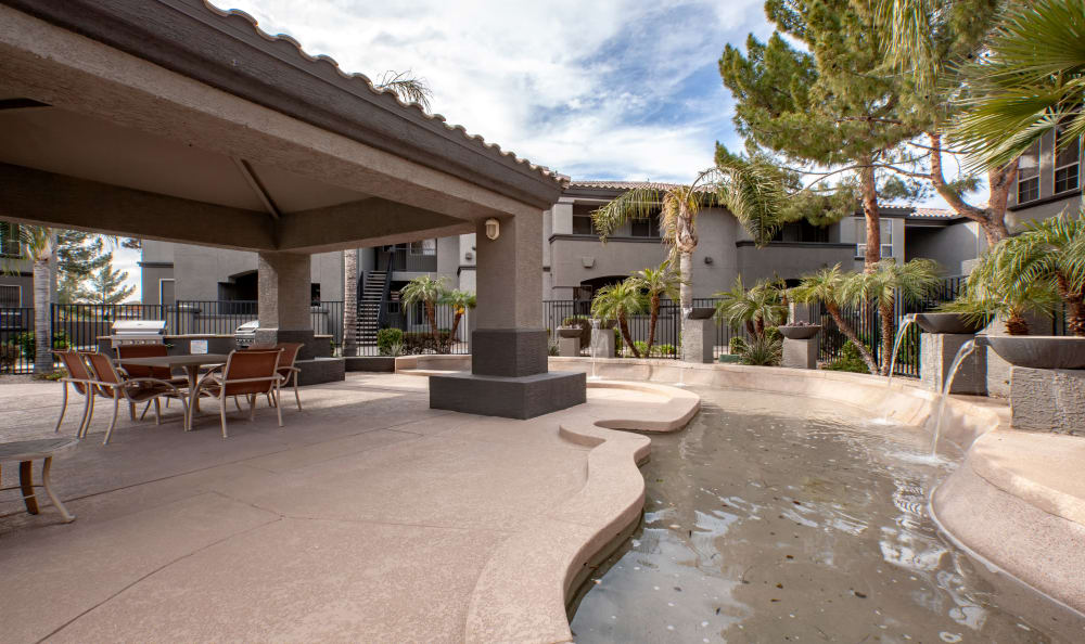 Water feature winding through exterior common areas at Sierra Canyon in Glendale, Arizona