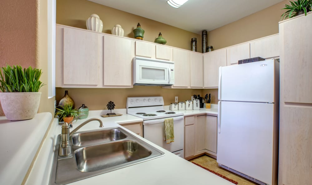 Granite-style countertops in a model home's kitchen at Sierra Canyon in Glendale, Arizona