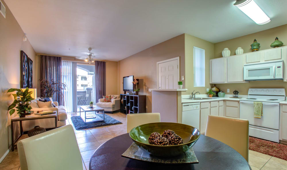 View of the living area and kitchen from the dining area of a model home at Sierra Canyon in Glendale, Arizona