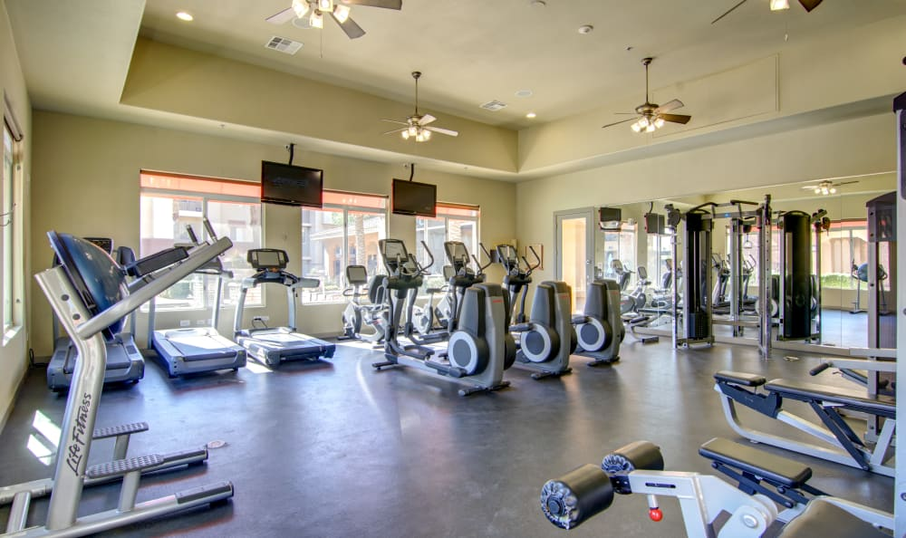 Well-equipped fitness center at The Residences at Stadium Village in Surprise, Arizona