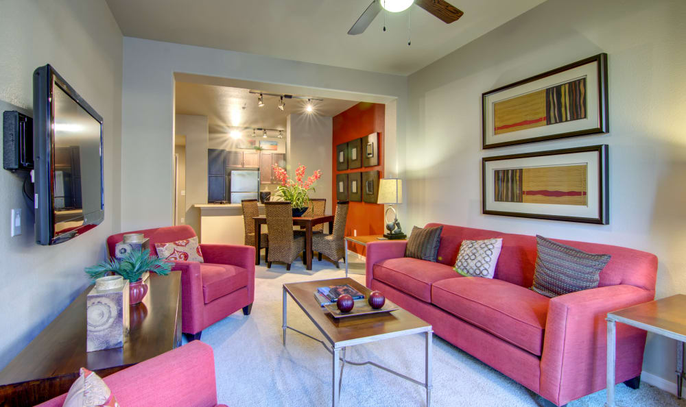Well-decorated living area in open-concept floor plan of a model home at The Residences at Stadium Village in Surprise, Arizona