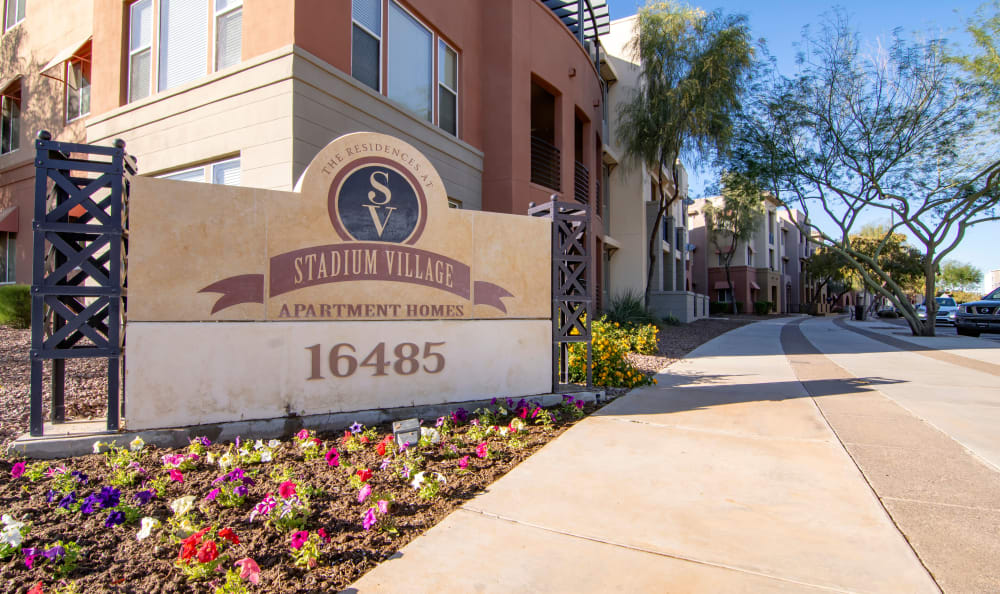 Monument sign outside our community welcoming residents and their guests to The Residences at Stadium Village in Surprise, Arizona