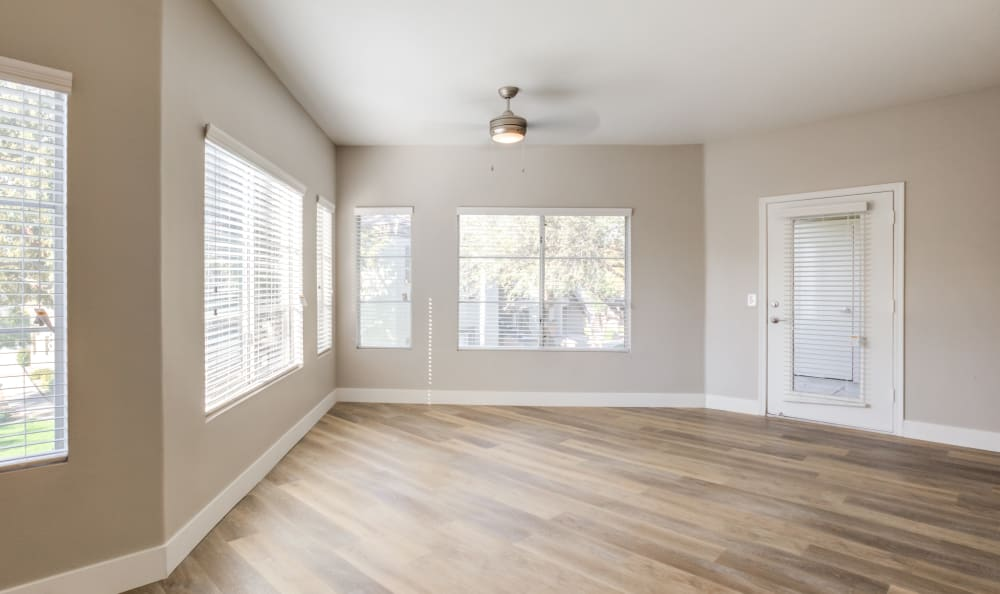 Large windows for plenty of natural light in the living area of an apartment home at Finisterra in Tempe, Arizona