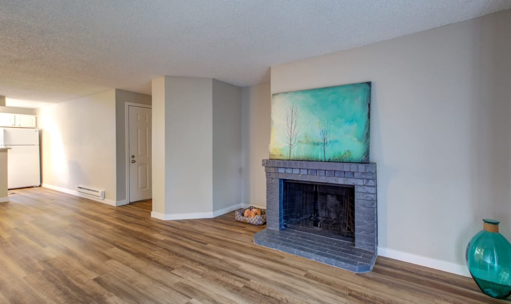 Living area with fireplace at Discovery Landing Apartment Homes in Burien, WA