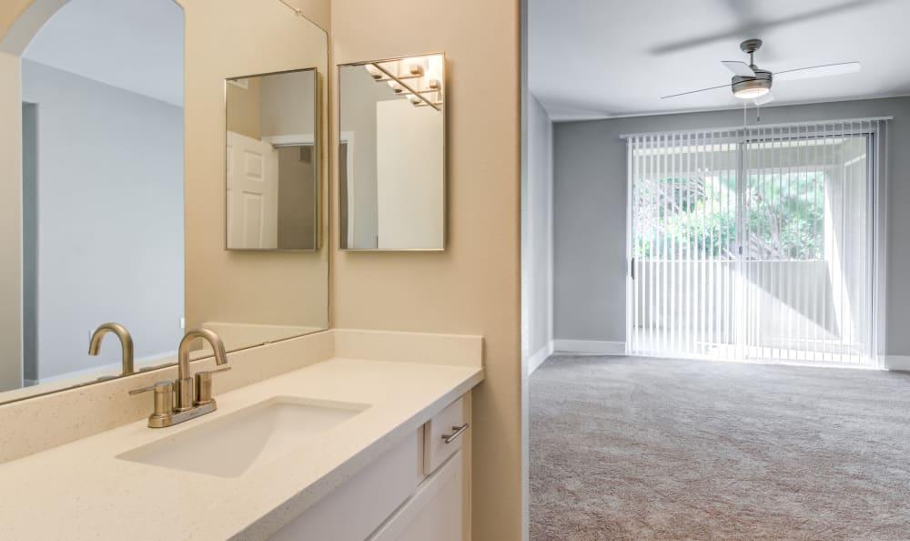 Large vanity mirror in apartment home's en suite master bathroom at Lumiere Chandler in Chandler, Arizona