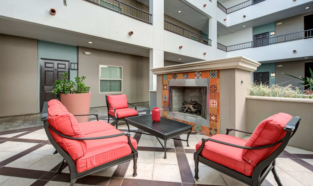Contemporary decor and a fireplace in the lobby at IMT Park Encino in Encino, California
