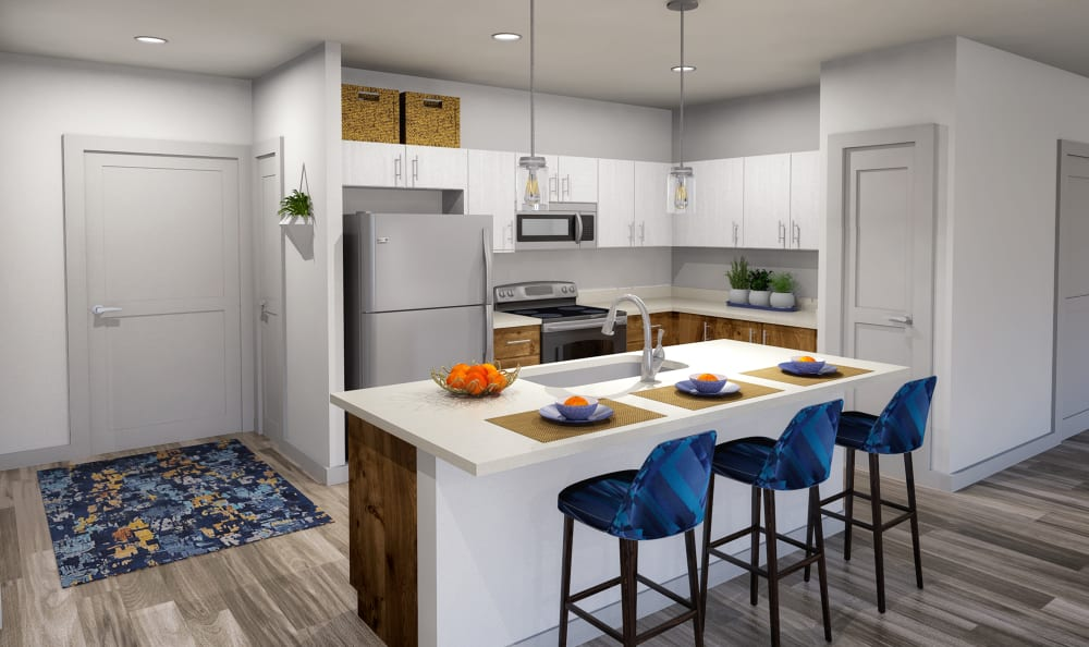 Full kitchen with island seating at Winding Creek Apartments in Webster, New York.
