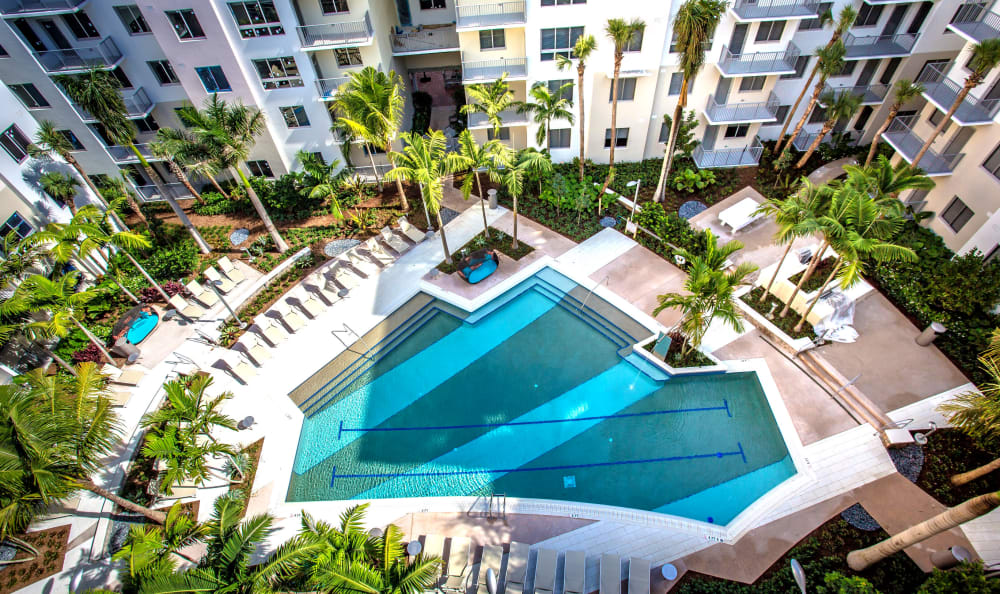 Aerial view of the pool area at Loftin Place Apartments in West Palm Beach, Florida