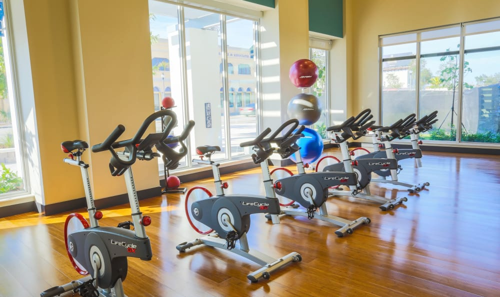 Spin class room at Loftin Place Apartments in West Palm Beach, Florida