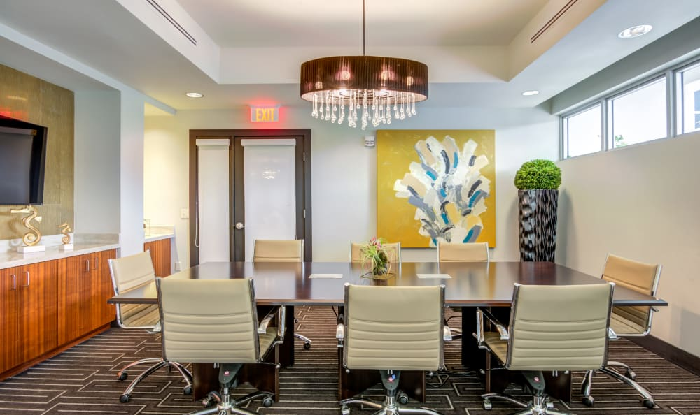 Conference room in the business center at Loftin Place Apartments in West Palm Beach, Florida