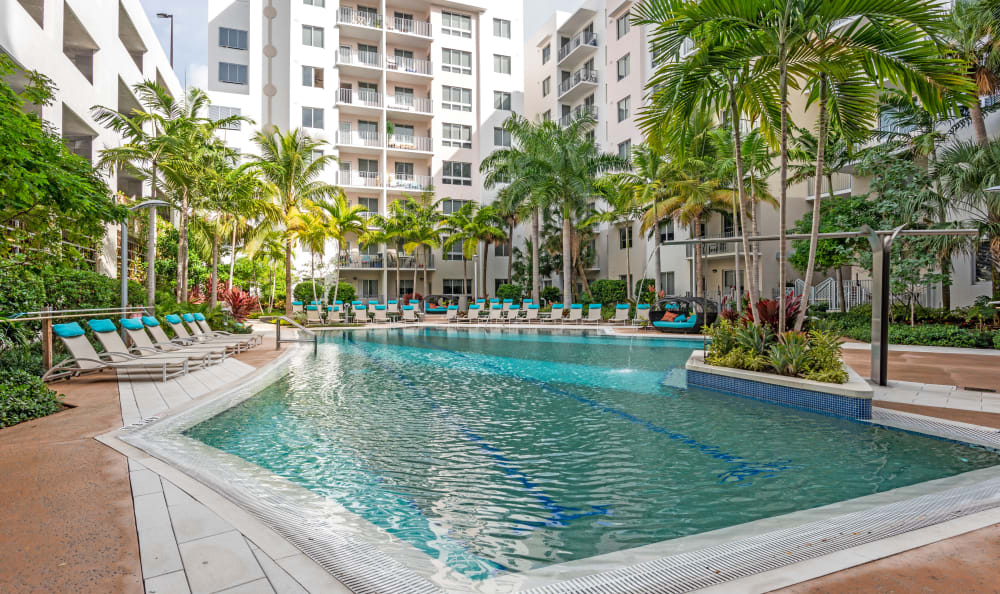 Beautiful swimming pool area at Loftin Place Apartments in West Palm Beach, Florida