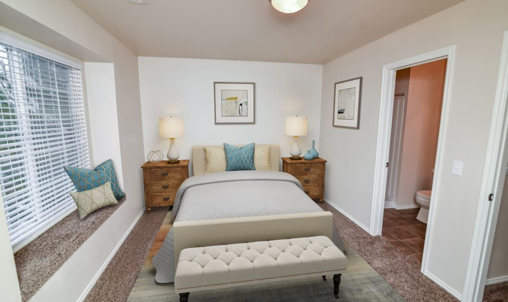 Bedroom at Cherry Lane Apartment Homes in Bountiful with built-in, window bench