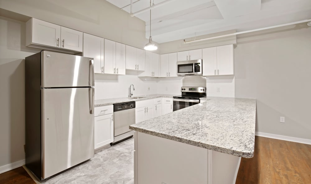 Large kitchen with white cabinets and granite countertops at 222 Saratoga in Baltimore, Maryland