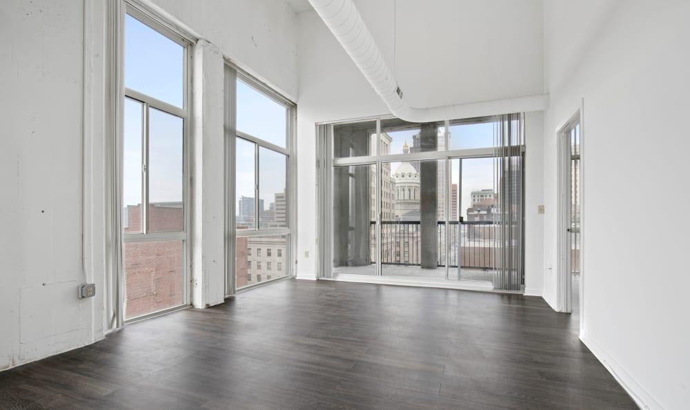 Large living room with plenty of windows to let in natural light at 222 Saratoga in Baltimore, Maryland