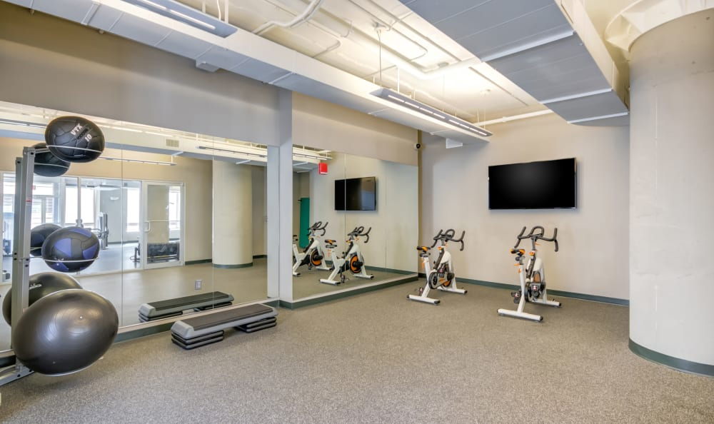 Spacious fitness center with spin bikes at 222 Saratoga in Baltimore, Maryland