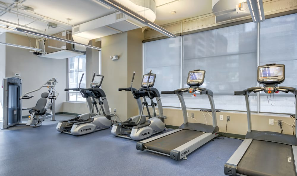 Fitness center with individual work stations at 222 Saratoga in Baltimore, Maryland