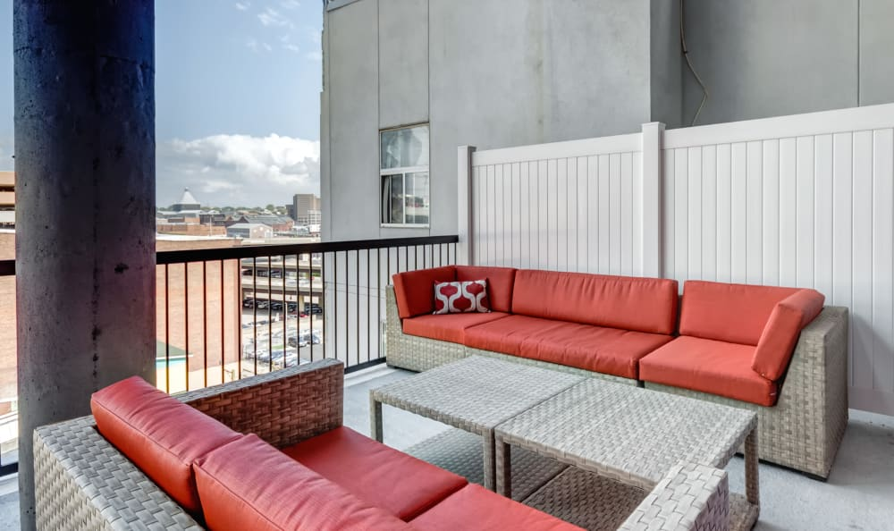 Outdoor patio seating with city views at 222 Saratoga in Baltimore, Maryland