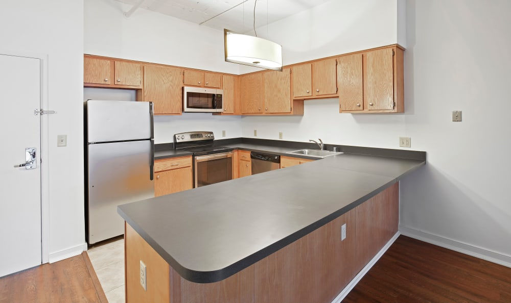 Modern kitchen with stainless-steal appliances at 222 Saratoga in Baltimore, Maryland