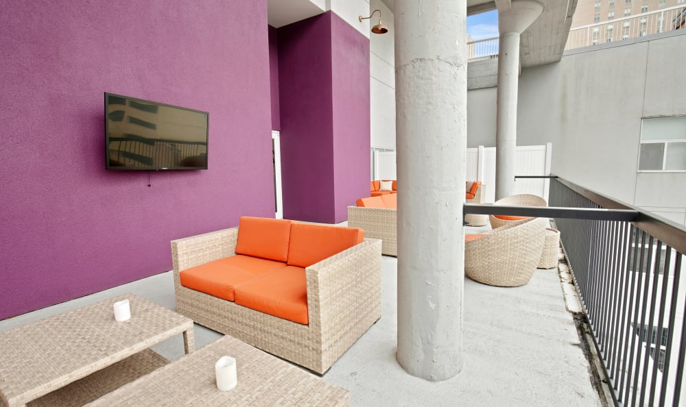 Large outdoor patio with flat-screen TVs at 222 Saratoga in Baltimore, Maryland