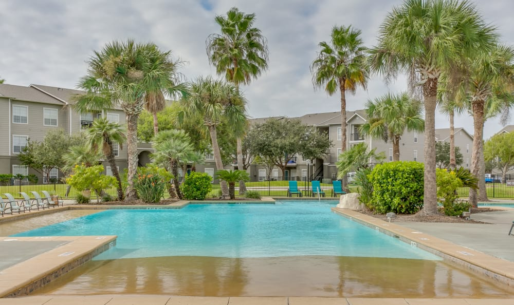 Swimming pool with sun deck at Azure Apartments in Corpus Christi, Texas