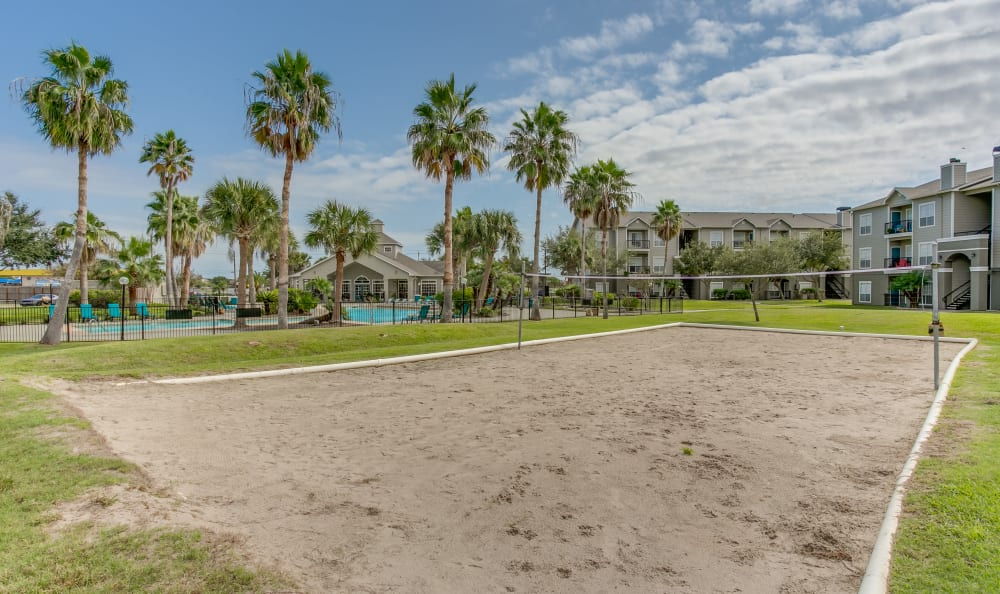 Onsite sand volleyball court at Azure Apartments in Corpus Christi, Texas