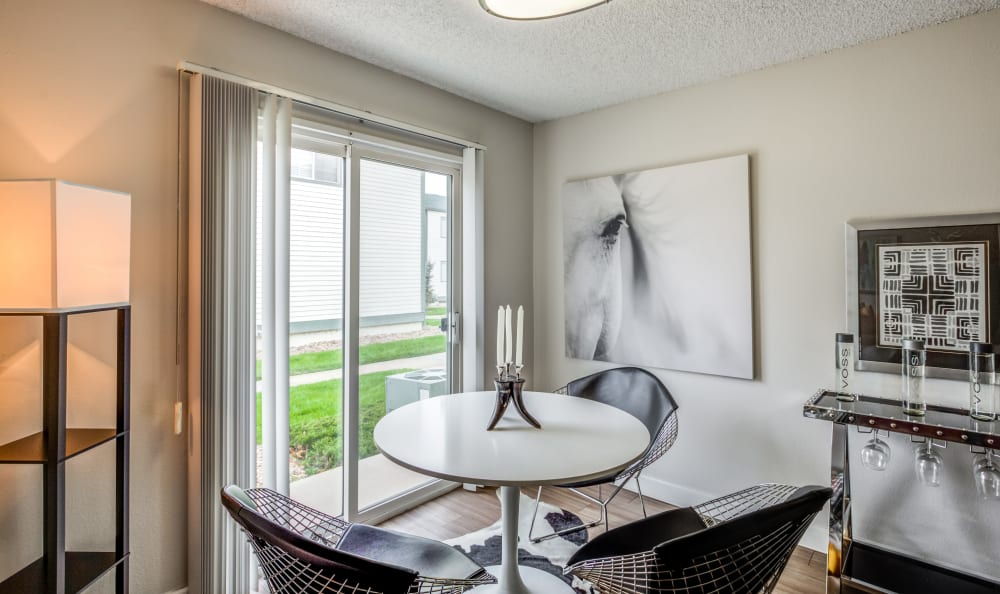 Dining nook near the sliding door to a model townhome's private patio at Stratus Townhomes in Westminster, Colorado