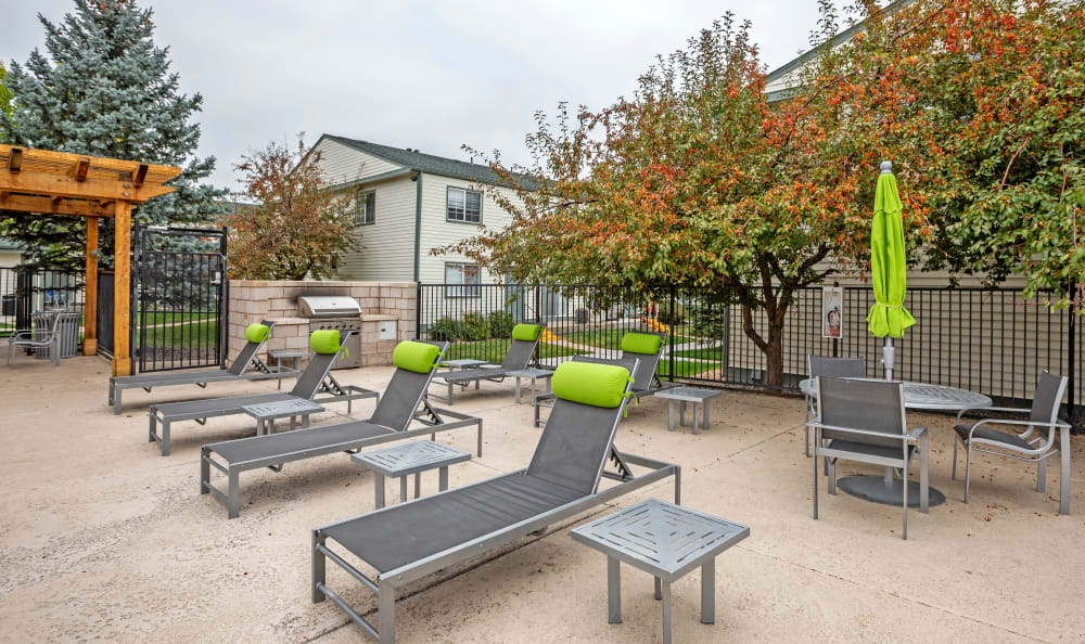 Chaise lounge chairs near the barbecue area at Stratus Townhomes in Westminster, Colorado