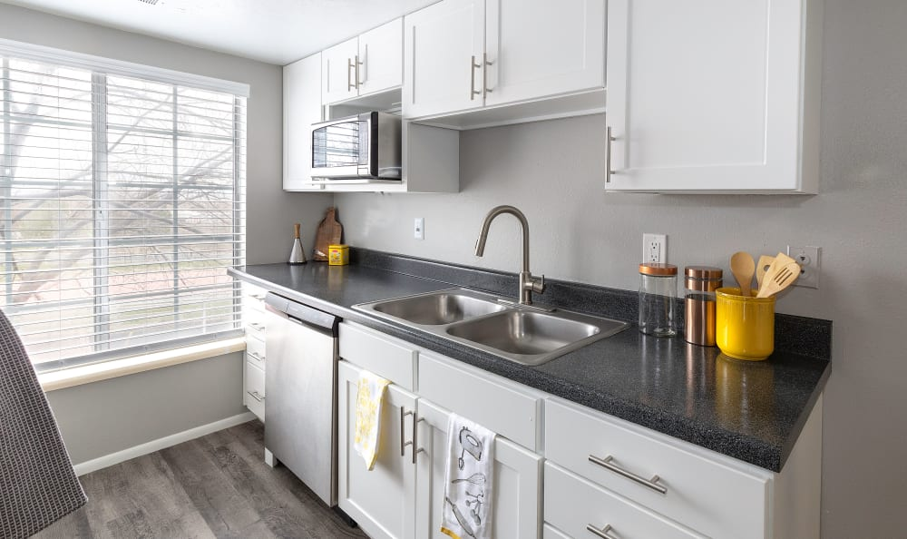 White Renovation Kitchen with stainless steel appliances