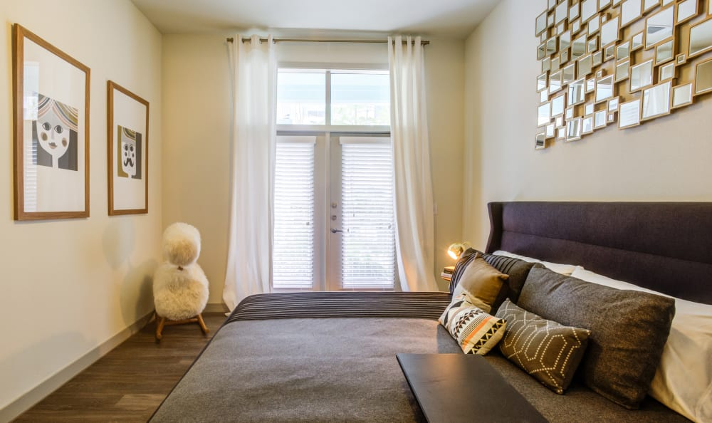 Well-decorated master bedroom with a ceiling fan in a model home at Agave in San Antonio, Texas
