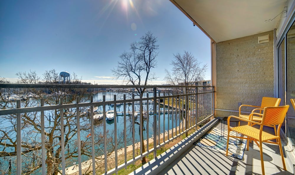 Private balcony overlooking the harbor on a sunny day at Watergate Pointe in Annapolis, Maryland