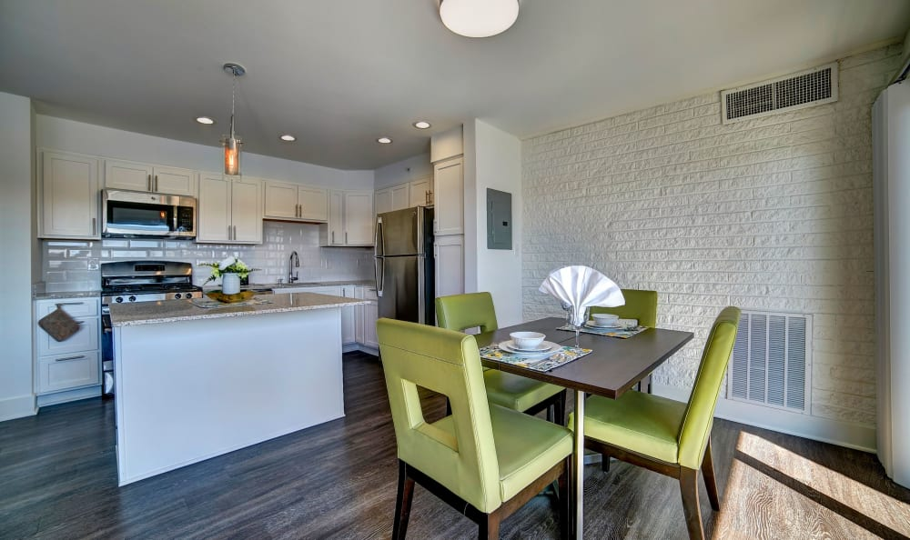View of the kitchen from the dining area in a model home at Watergate Pointe in Annapolis, Maryland