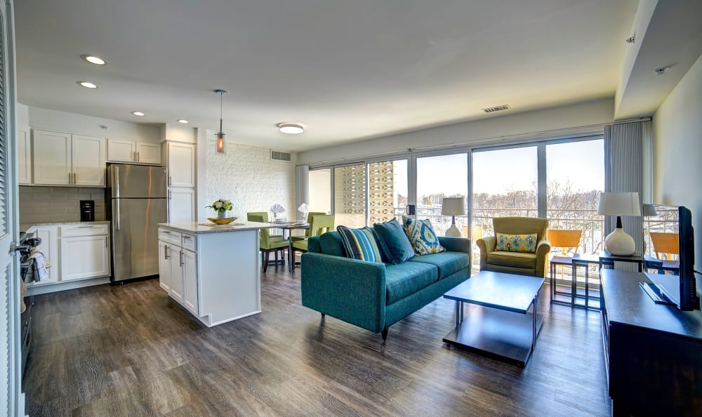 Well-decorated living area in an open concept layout with hardwood floors in a model home at Watergate Pointe in Annapolis, Maryland